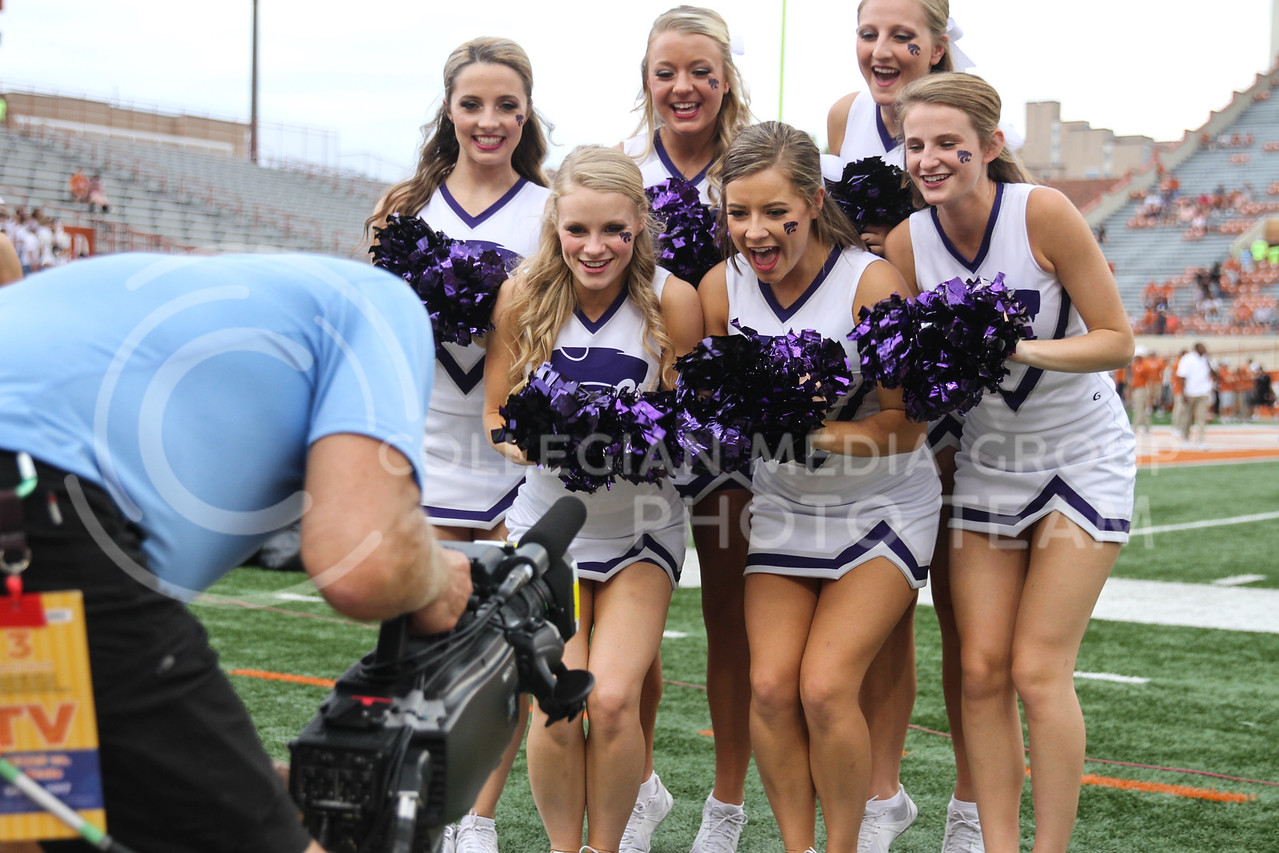 AUSTIN, TEXAS - OCTOBER 7: K-State Cheerleaders cheer while on TV during the football match between Kansas State University and University of Texas, Austin at Darrell K Royal Stadium on October 7th, 2017. (Photo by Cooper Kinley | Collegian Media Group)