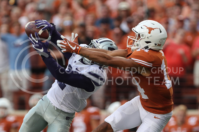 AUSTIN, TEXAS - OCTOBER 7: K-State defensive back #2 D.J. Reed intercepts the ball intended for UT Austin wide receiver #14 Lorenzo Joe during the football match between Kansas State University and University of Texas, Austin at Darrell K Royal Stadium on October 7th, 2017. (Photo by Cooper Kinley | Collegian Media Group)