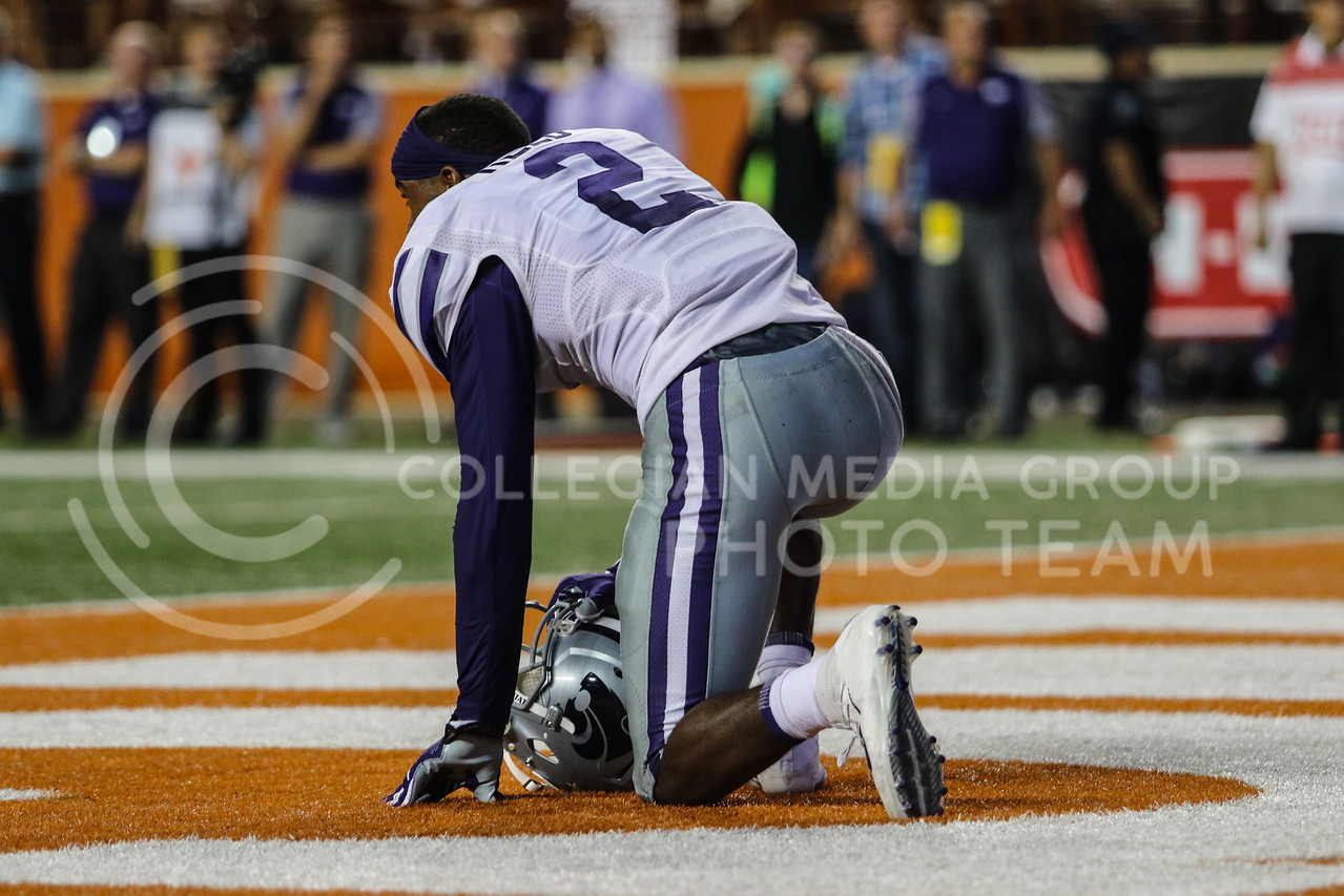 AUSTIN, TEXAS - OCTOBER 7: K-State defensive back #2 D.J. Reed kneels and reflects on the game after losing the football match between Kansas State University and University of Texas, Austin at Darrell K Royal Stadium on October 7th, 2017. (Photo by Cooper Kinley | Collegian Media Group)