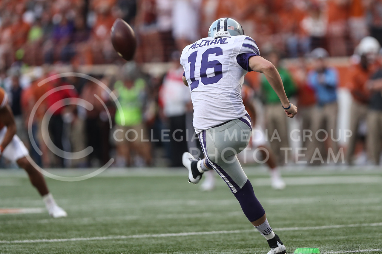 AUSTIN, TEXAS - OCTOBER 7: K-State kicker #16 Matthew McCrane kicks the ball during overtime during the football match between Kansas State University and University of Texas, Austin at Darrell K Royal Stadium on October 7th, 2017. (Photo by Cooper Kinley | Collegian Media Group)
