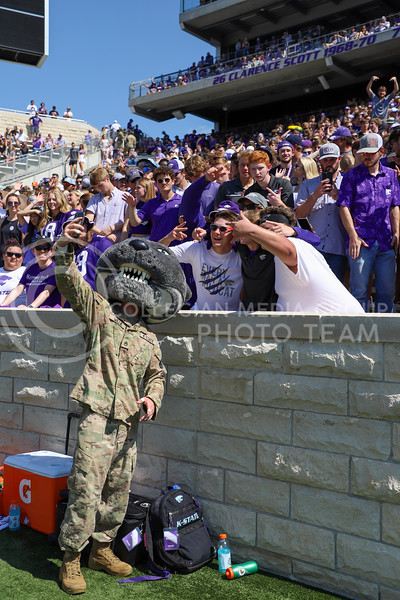 Willie Wildcat takes pictures with K-State fans during the September 18 game against the University of Nevada.