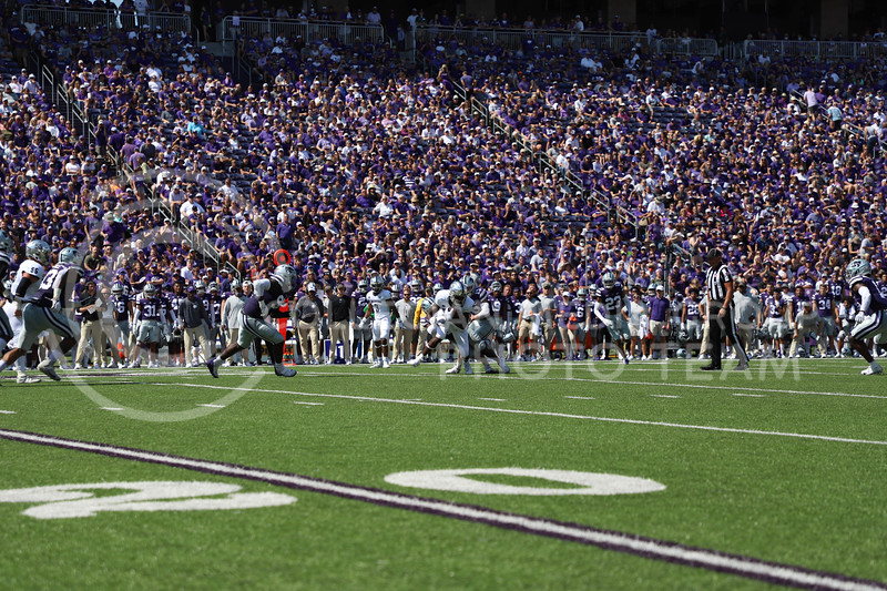 Two K-State defensive players take down a Nevada offensive player at the game on September 18, 2021.