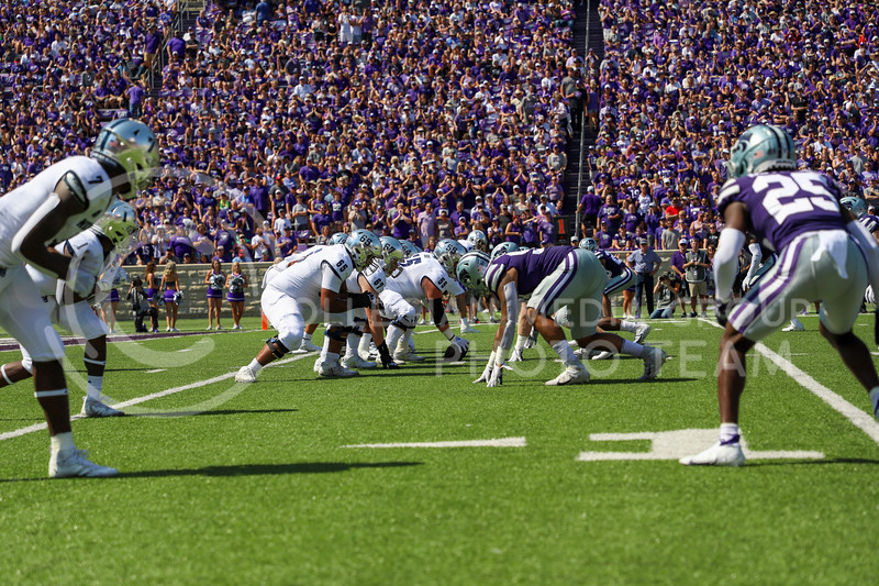 K-State's defensive line gets into position against the University of Nevada's offensive on September 18, 2021.