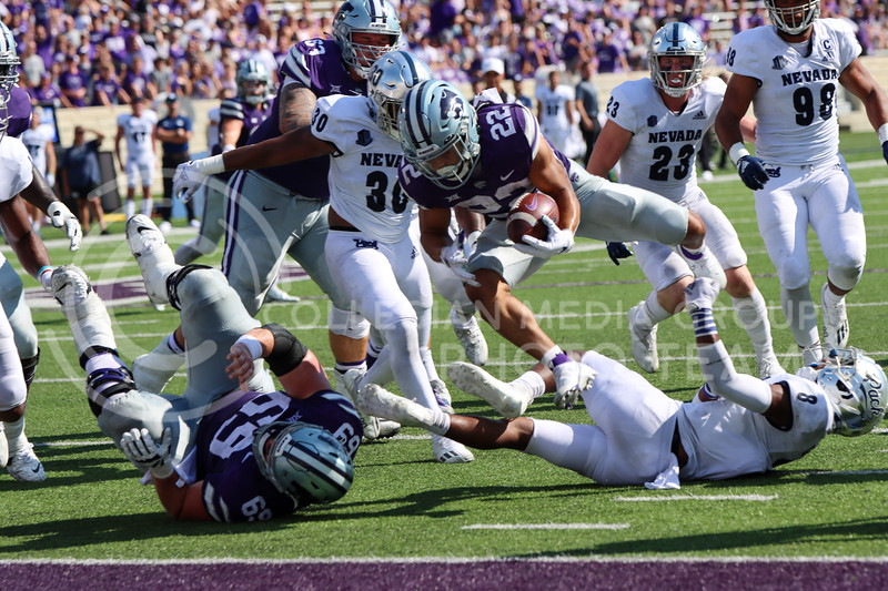 Deuce Vaugh, Sophomore in Business Administration, hurdles over UNR players to score a touchdown. KState beat UNR 38-17 on September 18th (Kendall Spencer | Collegian Media Group).