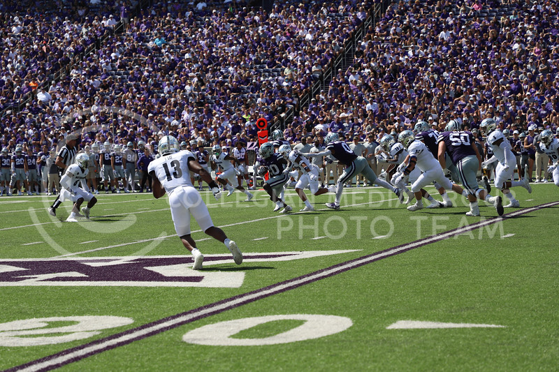 Running back Joe Ervin evades a tackle from the Nevada Wolf Pack. K-State won their game against Nevada on September 18, 2021.