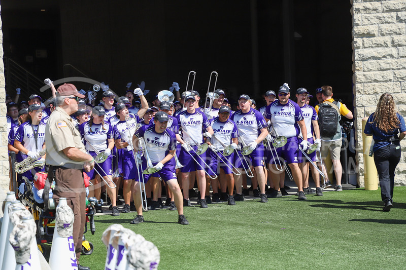 K-State marching band running onto the field for their pregane perfornance.