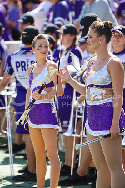 Nervously spinning, the KState Twirlers wait to take the field for the halftime show (Kendall Spencer | Collegian Media Group).