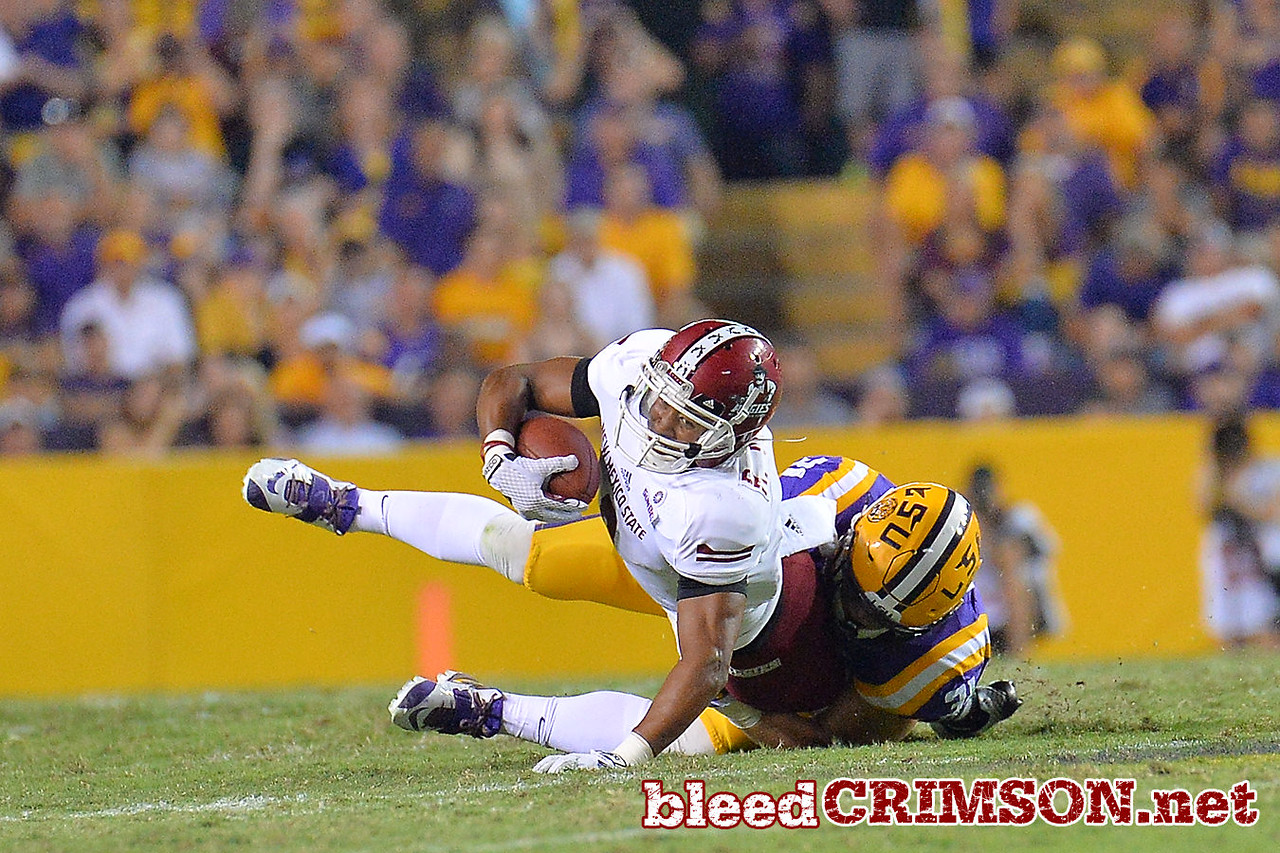 September 5, 2014: New Mexico State Aggies wide receiver Rayveon Moore (9) catches a pass during a game between New Mexico State and No. 17/18 LSU at Tiger Stadium in Baton Rouge, LA.
