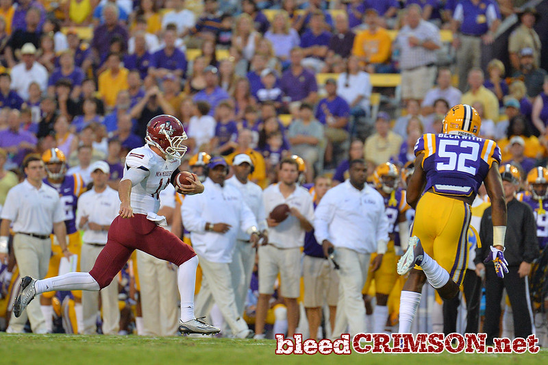 September 5, 2014: New Mexico State Aggies quarterback Tyler Rogers (18) keeps the ball during a game between New Mexico State and No. 17/18 LSU at Tiger Stadium in Baton Rouge, LA.