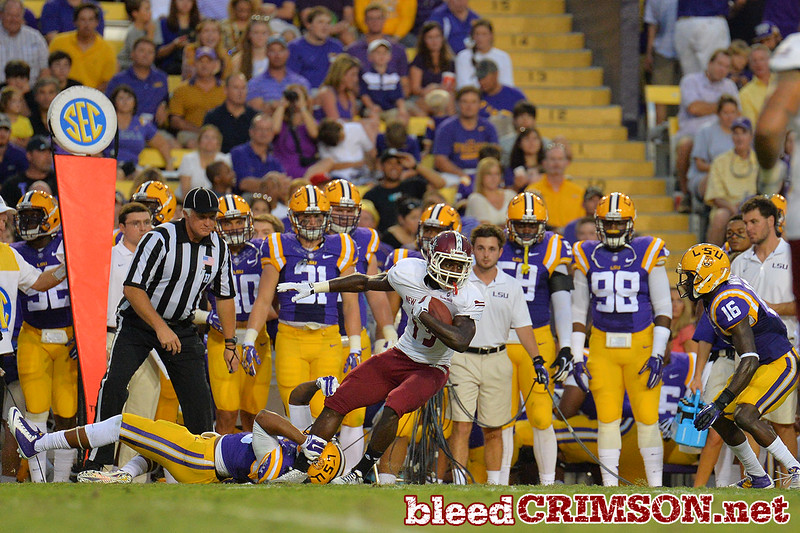 September 5, 2014: New Mexico State Aggies wide receiver Teldrick Morgan (19)  tries to escape a tackle during a game between New Mexico State and No. 17/18 LSU at Tiger Stadium in Baton Rouge, LA.