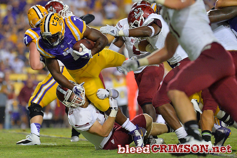 September 5, 2014: LSU Tigers running back Leonard Fournette (7) is tackled by an Aggie during a game between New Mexico State and No. 17/18 LSU at Tiger Stadium in Baton Rouge, LA.