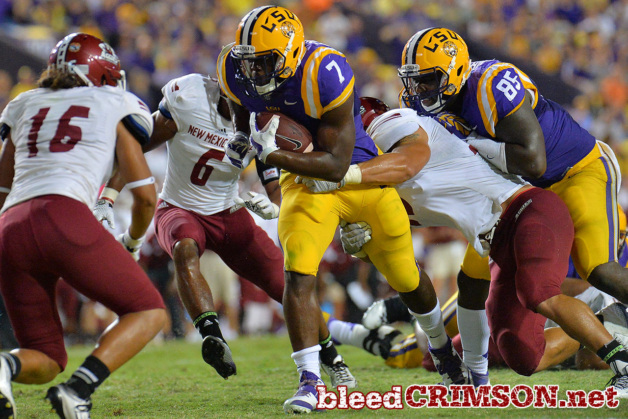 September 5, 2014: LSU Tigers running back Leonard Fournette (7) runs through the Aggie defenders during a game between New Mexico State and No. 17/18 LSU at Tiger Stadium in Baton Rouge, LA.