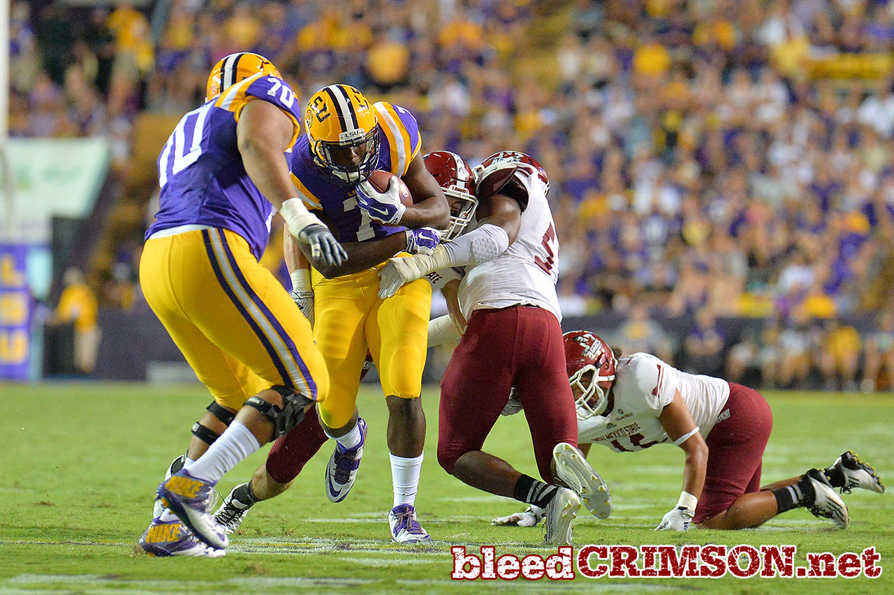September 5, 2014: LSU Tigers running back Leonard Fournette (7) runs into the Aggie defense during a game between New Mexico State and No. 17/18 LSU at Tiger Stadium in Baton Rouge, LA.