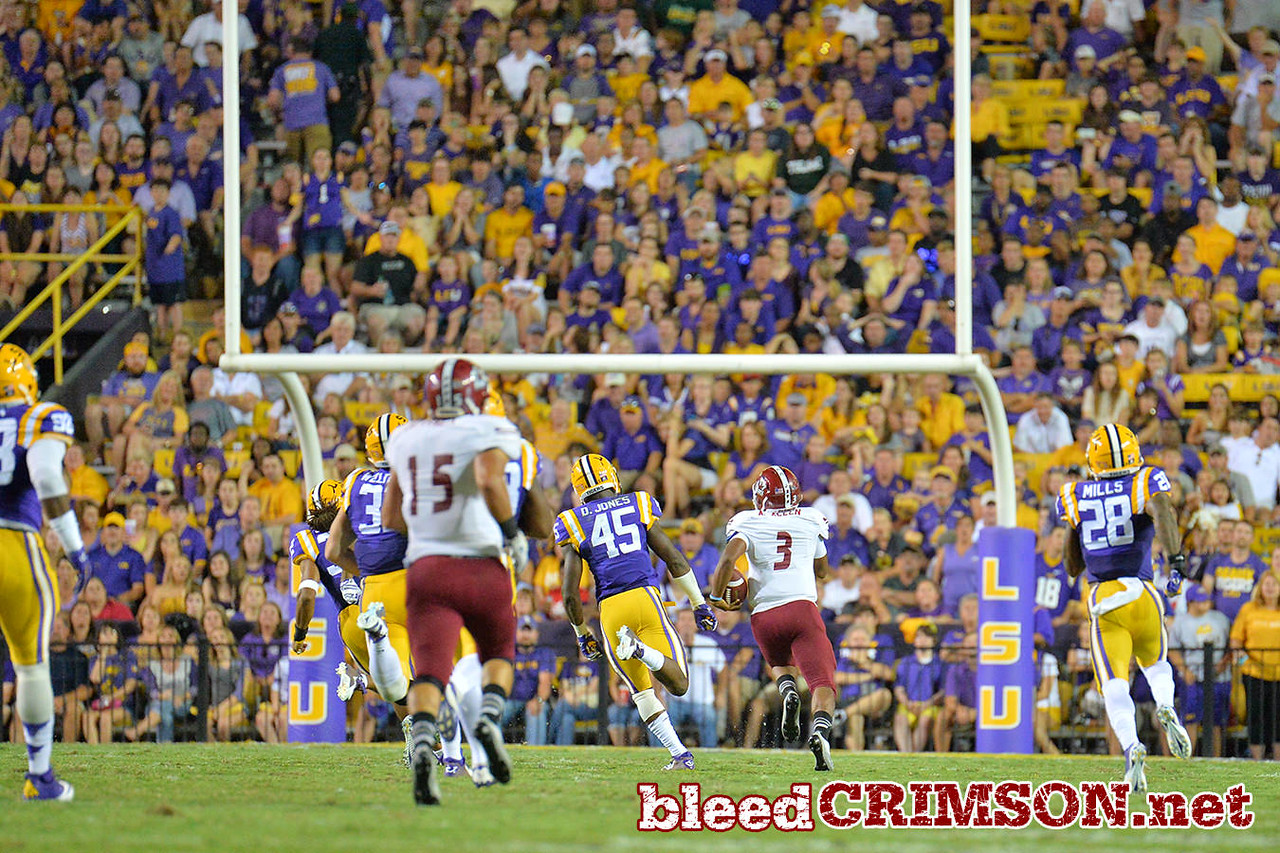 September 5, 2014: New Mexico State Aggies quarterback Andrew Allen (3) runs for a touchdown during a game between New Mexico State and No. 17/18 LSU at Tiger Stadium in Baton Rouge, LA.