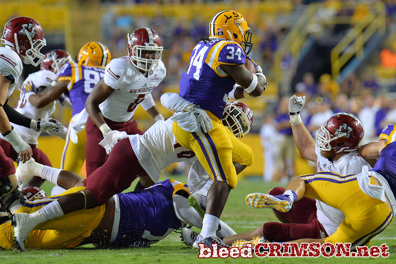 September 5, 2014: New Mexico State Aggies linebacker Dior Moore (46) tackles LSU Tigers running back Darrel Williams (34) during a game between New Mexico State and No. 17/18 LSU at Tiger Stadium in Baton Rouge, LA.