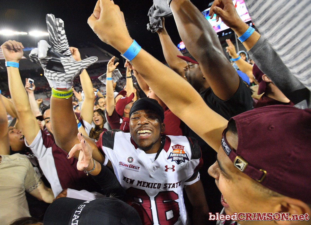 December 29, 2017; Tucson, AZ, USA;  New Mexico State Aggies wide receiver Troy Posey (86) celebrates with fans after the team won the the NOVA Home Loans Arizona Bowl against the Utah State Aggies 26-20 at Arizona Stadium in Tucson, Ariz.  Photo by Sam Wasson/bleedCrimson.net