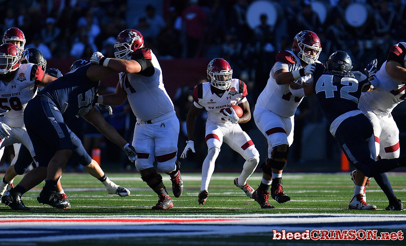 December 29, 2017; Tucson, AZ, USA;  New Mexico State Aggies running back Jason Huntley (1) looks for a hole to run through against the Utah State Aggies during the NOVA Home Loans Arizona Bowl at Arizona Stadium in Tucson, Ariz.  Photo by Sam Wasson/bleedCrimson.net