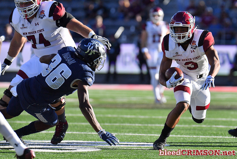 December 29, 2017; Tucson, AZ, USA;  New Mexico State Aggies running back Larry Rose III (3) runs for a gain against Utah State Aggies cornerback Ja'Marcus Ingram (36) during the NOVA Home Loans Arizona Bowl at Arizona Stadium in Tucson, Ariz.  Photo by Sam Wasson/bleedCrimson.net