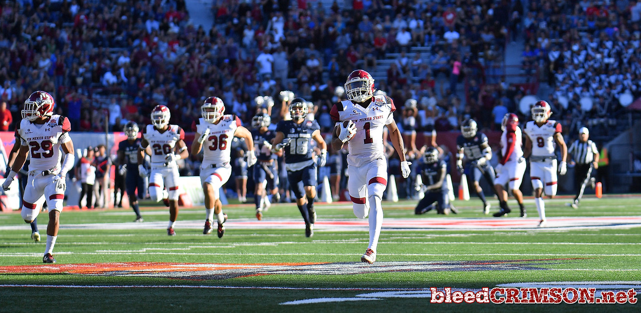 December 29, 2017; Tucson, AZ, USA;  New Mexico State Aggies running back Jason Huntley (1) returns a kickoff for a touchdown against the Utah State Aggies  during the NOVA Home Loans Arizona Bowl at Arizona Stadium in Tucson, Ariz.  Photo by Sam Wasson/bleedCrimson.net