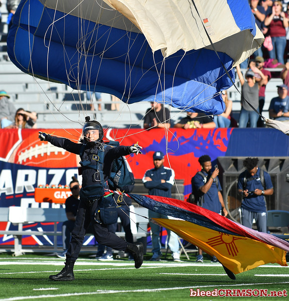 December 29, 2017; Tucson, AZ, USA;  A member of the Wings of Blue parachute team lands in the stadium before the game between the New Mexico State Aggies and the Utah State Aggies at the NOVA Home Loans Arizona Bowl at Arizona Stadium in Tucson, Ariz.  Photo by Sam Wasson/bleedCrimson.net