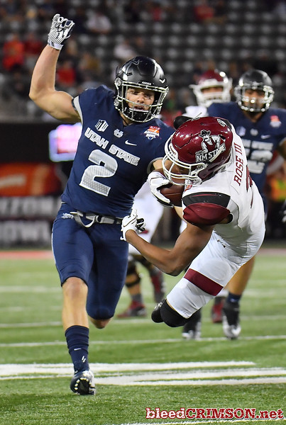 December 29, 2017; Tucson, AZ, USA;  New Mexico State Aggies running back Larry Rose III (3) makes a diving catch against Utah State Aggies safety Dallin Leavitt (2) during the NOVA Home Loans Arizona Bowl at Arizona Stadium in Tucson, Ariz.  Photo by Sam Wasson/bleedCrimson.net