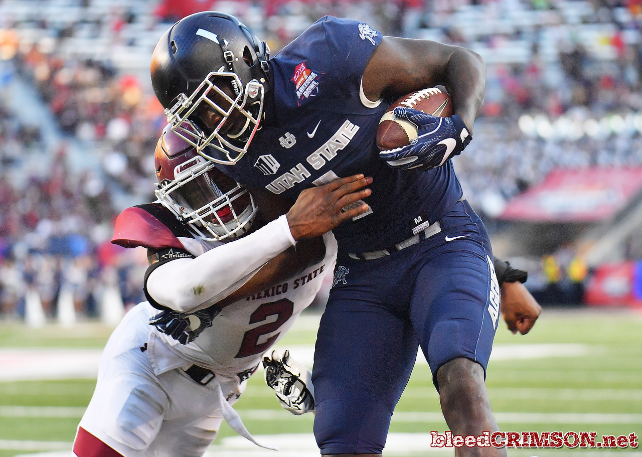 December 29, 2017; Tucson, AZ, USA;  New Mexico State Aggies linebacker Terrill Hanks (2) tackles Utah State Aggies wide receiver Ron'quavion Tarver (1) during the NOVA Home Loans Arizona Bowl at Arizona Stadium in Tucson, Ariz.  Photo by Sam Wasson/bleedCrimson.net