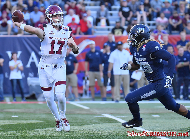 December 29, 2017; Tucson, AZ, USA;  New Mexico State Aggies quarterback Tyler Rogers (17) throws a pass against Utah State Aggies linebacker Maika Magalei (39) during the NOVA Home Loans Arizona Bowl at Arizona Stadium in Tucson, Ariz.  Photo by Sam Wasson/bleedCrimson.net