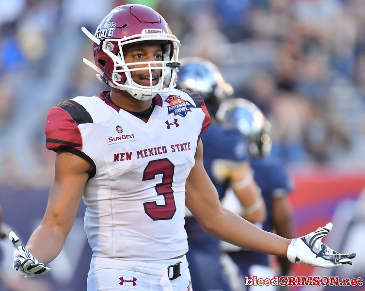 December 29, 2017; Tucson, AZ, USA;  New Mexico State Aggies running back Larry Rose III (3) gestures toward the sideline during the team's game against the Utah State Aggies during the NOVA Home Loans Arizona Bowl at Arizona Stadium in Tucson, Ariz.  Photo by Sam Wasson/bleedCrimson.net