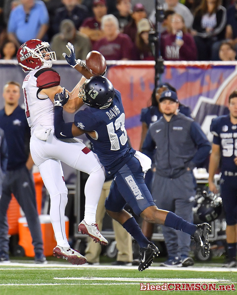December 29, 2017; Tucson, AZ, USA;  Utah State Aggies cornerback Jalen Davis (13) breaks up a pass intended for New Mexico State Aggies wide receiver Conner Cramer (11) during the NOVA Home Loans Arizona Bowl at Arizona Stadium in Tucson, Ariz.  Photo by Sam Wasson/bleedCrimson.net
