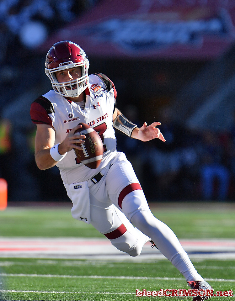 December 29, 2017; Tucson, AZ, USA;  New Mexico State Aggies quarterback Tyler Rogers (17) runs for a gain against the Utah State Aggies during the NOVA Home Loans Arizona Bowl at Arizona Stadium in Tucson, Ariz.  Photo by Sam Wasson/bleedCrimson.net