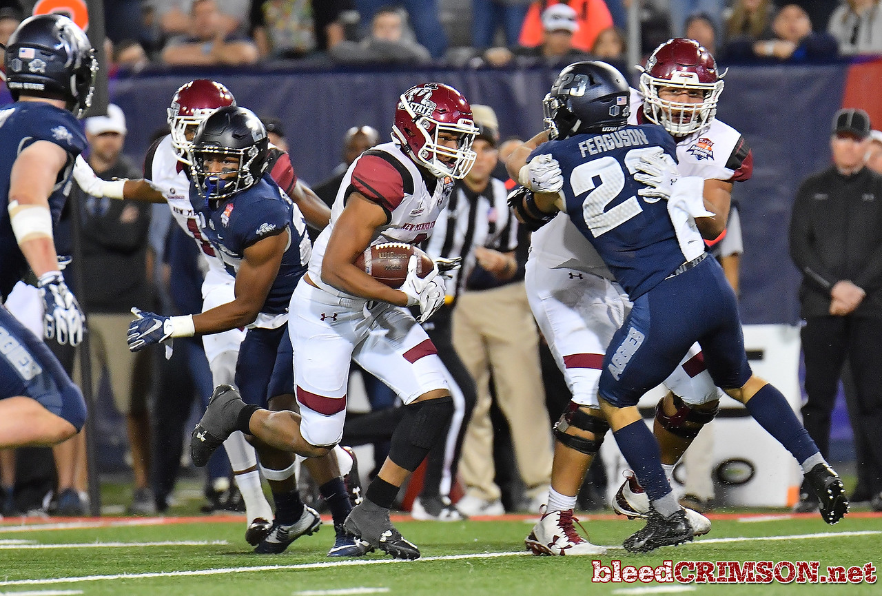 December 29, 2017; Tucson, AZ, USA;  New Mexico State Aggies running back Larry Rose III (3) runs for the game-winning touchdown against the Utah State Aggies during the NOVA Home Loans Arizona Bowl at Arizona Stadium in Tucson, Ariz.  Photo by Sam Wasson/bleedCrimson.net
