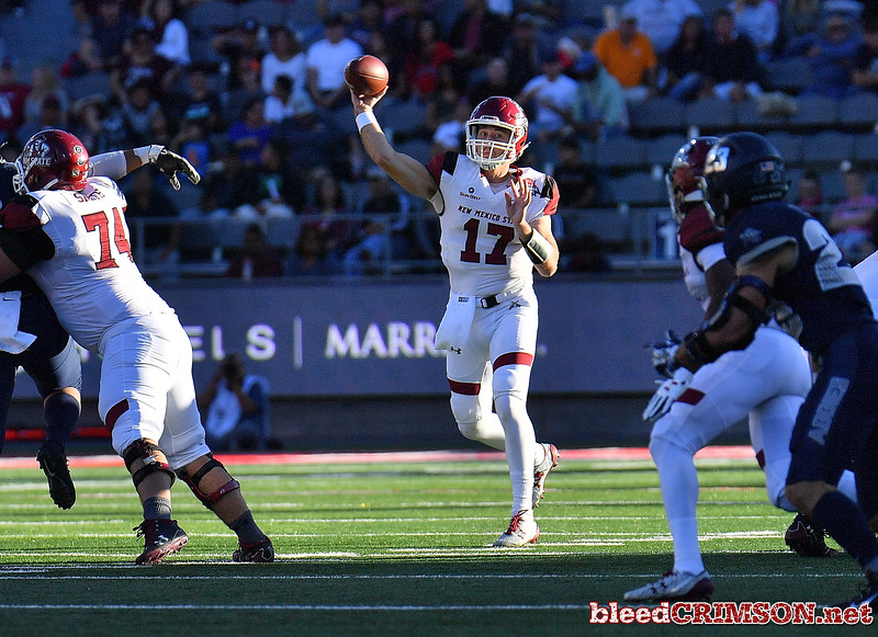December 29, 2017; Tucson, AZ, USA;  New Mexico State Aggies quarterback Tyler Rogers (17) throws a pass against the Utah State Aggies during the NOVA Home Loans Arizona Bowl at Arizona Stadium in Tucson, Ariz.  Photo by Sam Wasson/bleedCrimson.net