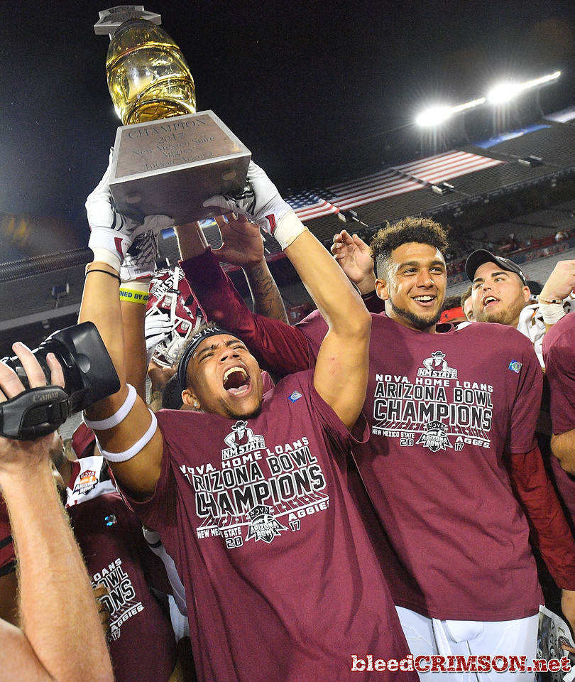 December 29, 2017; Tucson, AZ, USA;  New Mexico State Aggies players celebrate after the team won the NOVA Home Loans Arizona Bowl 26-20 over the Utah State Aggies at Arizona Stadium in Tucson, Ariz.  Photo by Sam Wasson/bleedCrimson.net