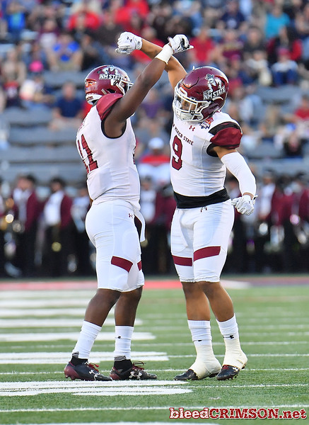 December 29, 2017; Tucson, AZ, USA;  New Mexico State Aggies defensive back Malik Demby (11) and New Mexico State Aggies defensive lineman Stody Bradley (9) celebrate after a play during the team's game against the Utah State Aggies during the NOVA Home Loans Arizona Bowl at Arizona Stadium in Tucson, Ariz.  Photo by Sam Wasson/bleedCrimson.net