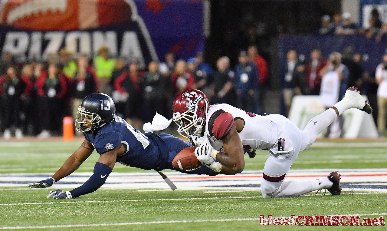 December 29, 2017; Tucson, AZ, USA;  New Mexico State Aggies wide receiver Jaleel Scott (16) drops a pass late in the fourth quarter as he's defended by Utah State Aggies cornerback Jalen Davis (13) during the NOVA Home Loans Arizona Bowl at Arizona Stadium in Tucson, Ariz.  Photo by Sam Wasson/bleedCrimson.net