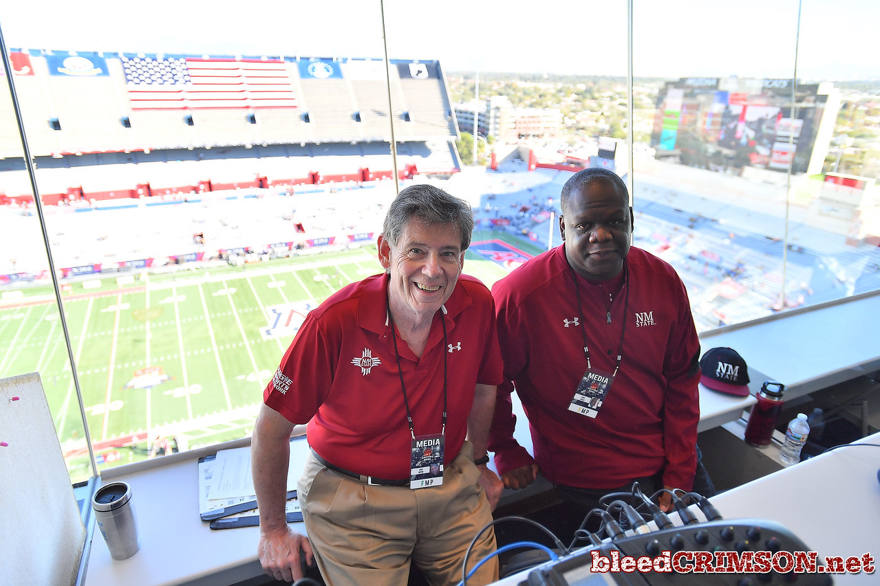 December 29, 2017; Tucson, AZ, USA;  New Mexico State Aggies Hall of Fame broadcaster Jack Nixon (L) and Cory Lucas pose for a photo before the team's game against the Utah State Aggies at the NOVA Home Loans Arizona Bowl at Arizona Stadium in Tucson, Ariz.  Photo by Sam Wasson/bleedCrimson.net
