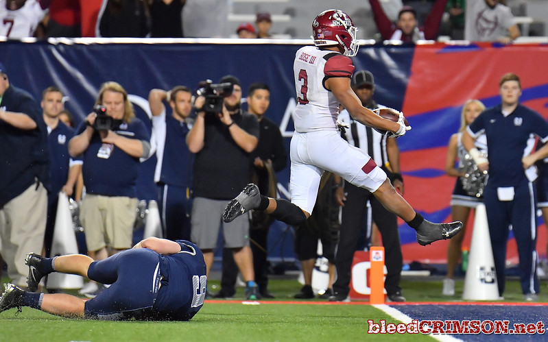 December 29, 2017; Tucson, AZ, USA;  New Mexico State Aggies running back Larry Rose III (3) scores the game-winning touchdown in overtime against the Utah State Aggies during the NOVA Home Loans Arizona Bowl at Arizona Stadium in Tucson, Ariz.  Photo by Sam Wasson/bleedCrimson.net
