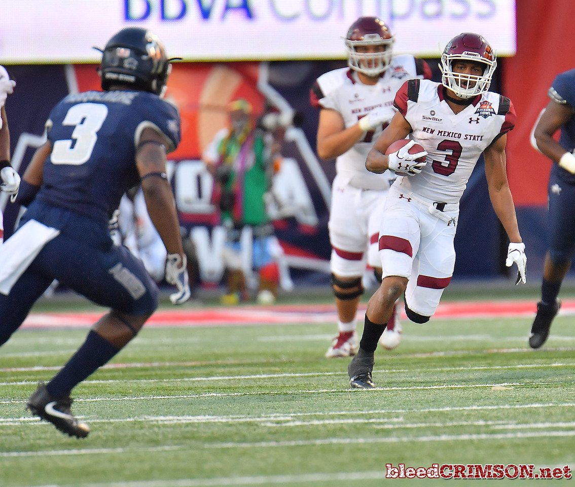December 29, 2017; Tucson, AZ, USA;  New Mexico State Aggies running back Larry Rose III (3) runs for a gain against the Utah State Aggies during the NOVA Home Loans Arizona Bowl at Arizona Stadium in Tucson, Ariz.  Photo by Sam Wasson/bleedCrimson.net