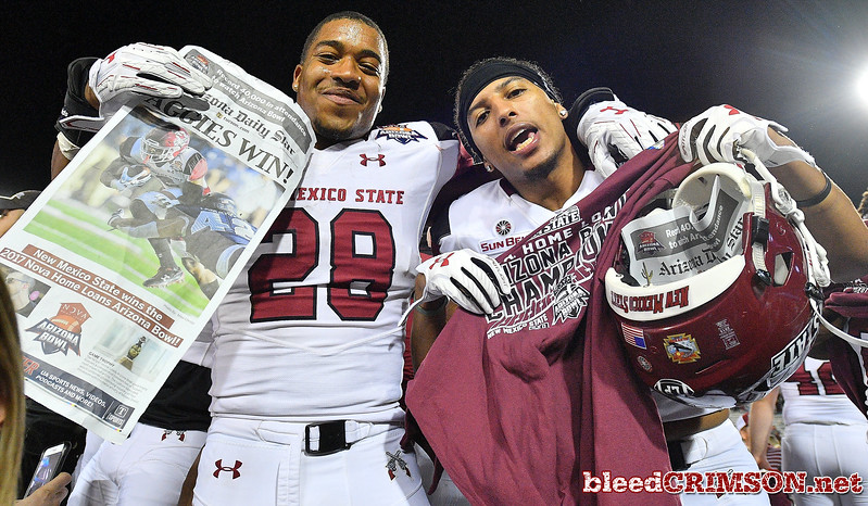December 29, 2017; Tucson, AZ, USA;  New Mexico State Aggies players celebrate after the team's 26-20 victory in overtime over the Utah State Aggies at the NOVA Home Loans Arizona Bowl at Arizona Stadium in Tucson, Ariz.  Photo by Sam Wasson/bleedCrimson.net