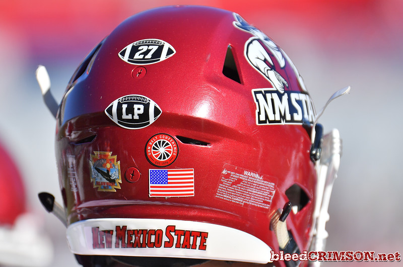 "December 29, 2017; Tucson, AZ, USA;  A general view shows ""27"" and ""LP"" helmet stickers memorializing All-American and College Football Hall of Fame running back Pervis Atkins, and Lori Paulson during the NOVA Home Loans Arizona Bowl at Arizona Stadium in Tucson, Ariz. Atkins passed away just prior to the bowl game while Paulson, an Aggie football booster, succumbed to pancreatic cancer in 2016.  Photo by Sam Wasson/bleedCrimson.net"