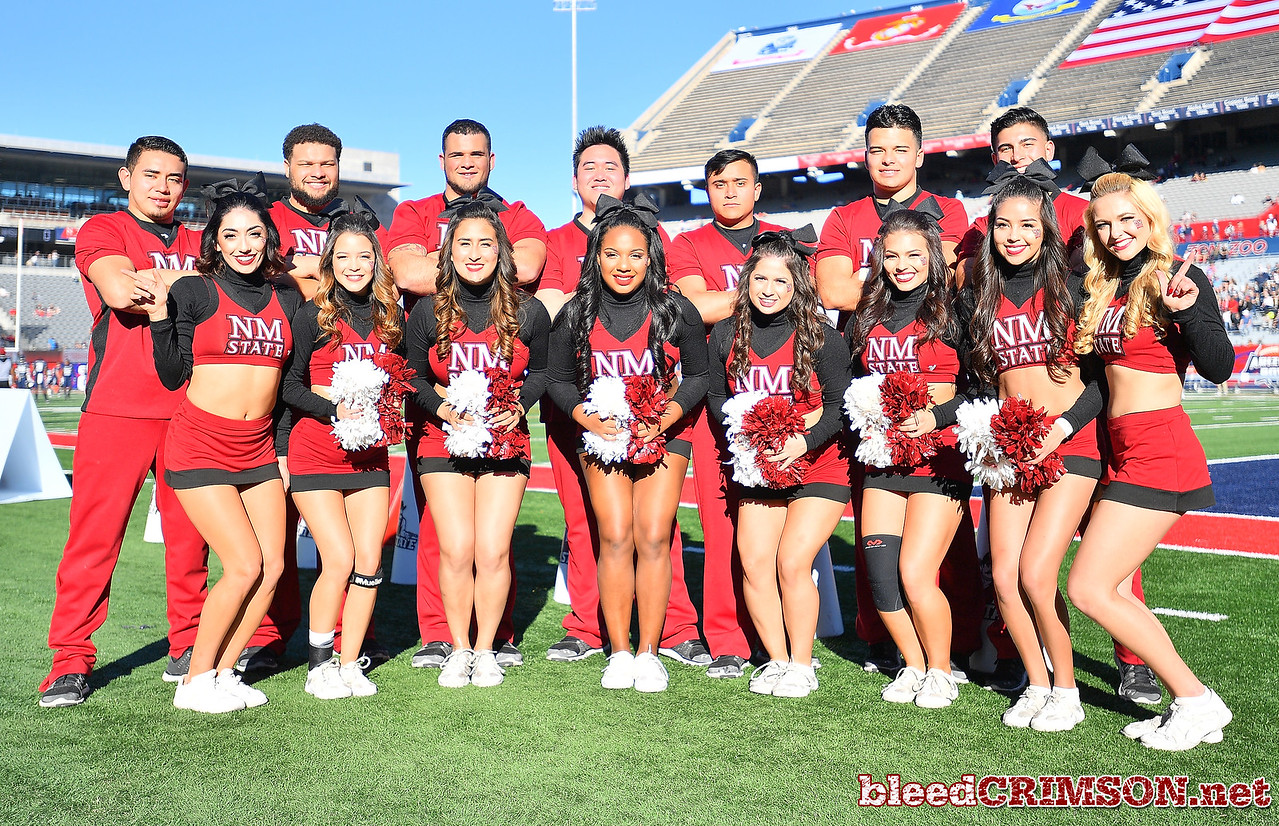 December 29, 2017; Tucson, AZ, USA;  The New Mexico State Aggies cheerleaders pose for a photo before the team's game against the Utah State Aggies during the NOVA Home Loans Arizona Bowl at Arizona Stadium in Tucson, Ariz.  Photo by Sam Wasson/bleedCrimson.net