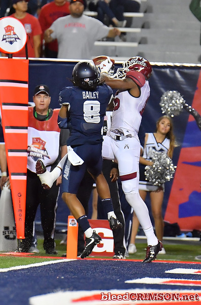 December 29, 2017; Tucson, AZ, USA;  New Mexico State Aggies wide receiver Jaleel Scott (16) catches the game-tying touchdown against Utah State Aggies cornerback Wesley Bailey (8) during the NOVA Home Loans Arizona Bowl at Arizona Stadium in Tucson, Ariz.  Photo by Sam Wasson/bleedCrimson.net