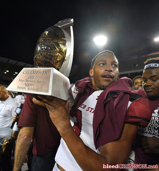 December 29, 2017; Tucson, AZ, USA;  New Mexico State Aggies running back Larry Rose III (3) holds the trophy after the Aggies won the NOVA Home Loans Arizona Bowl 26-20 over the Utah State Aggies at Arizona Stadium in Tucson, Ariz.  Photo by Sam Wasson/bleedCrimson.net