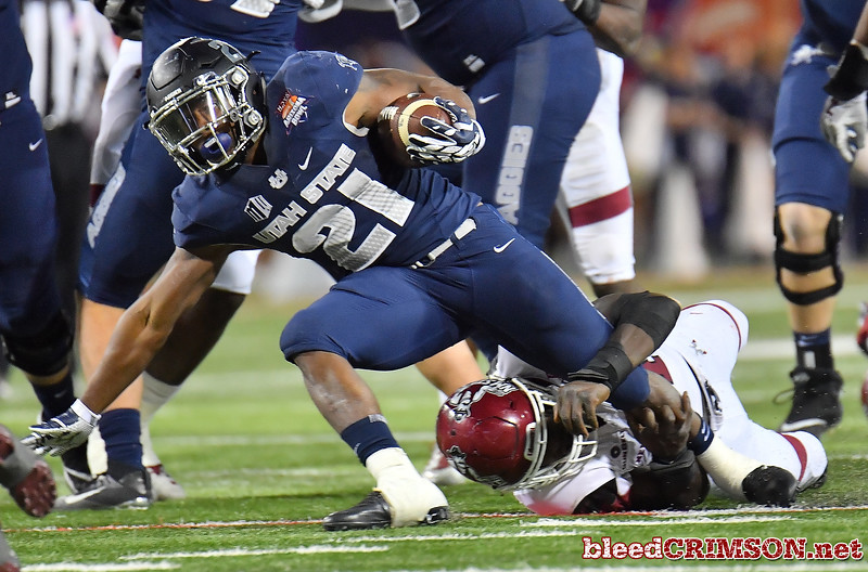 December 29, 2017; Tucson, AZ, USA;  New Mexico State Aggies linebacker Leon McQuaker (41) tackles Utah State Aggies running back LaJuan Hunt (21) during the NOVA Home Loans Arizona Bowl at Arizona Stadium in Tucson, Ariz.  Photo by Sam Wasson/bleedCrimson.net