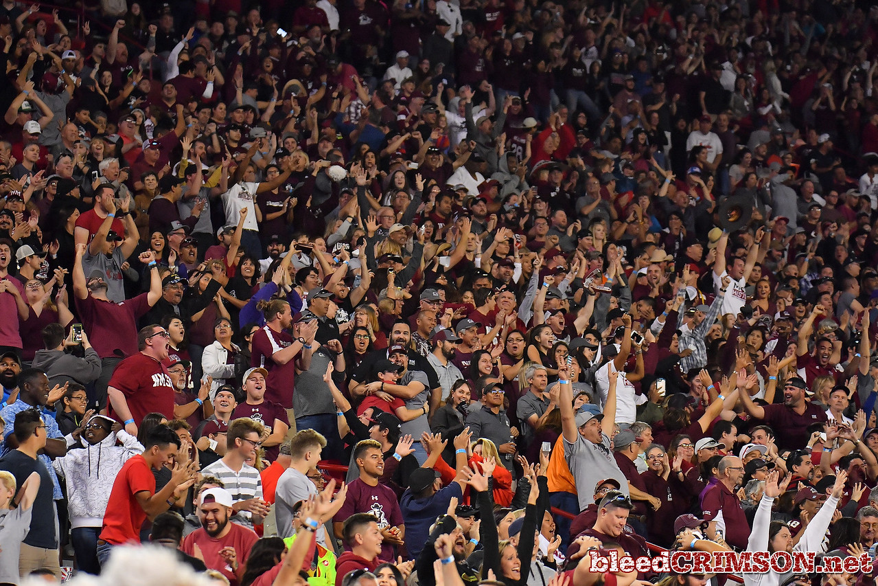 December 29, 2017; Tucson, AZ, USA;  New Mexico State Aggies fans celebrate after a missed field goal by Utah State Aggies place kicker Dominik Eberle (62) in overtime during the NOVA Home Loans Arizona Bowl at Arizona Stadium in Tucson, Ariz.  Photo by Sam Wasson/bleedCrimson.net