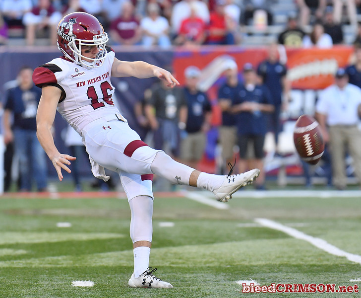 December 29, 2017; Tucson, AZ, USA;  New Mexico State Aggies punter Peyton Theisler (16) punts against teh Utah State Aggies during the NOVA Home Loans Arizona Bowl at Arizona Stadium in Tucson, Ariz.  Photo by Sam Wasson/bleedCrimson.net