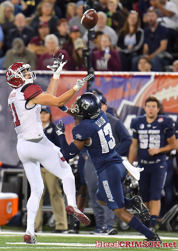 December 29, 2017; Tucson, AZ, USA;  New Mexico State Aggies wide receiver Conner Cramer (11) tries to haul in a pass against Utah State Aggies cornerback Jalen Davis (13) during the NOVA Home Loans Arizona Bowl at Arizona Stadium in Tucson, Ariz.  Photo by Sam Wasson/bleedCrimson.net