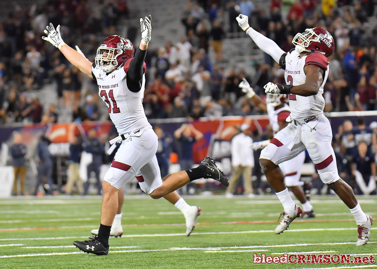 December 29, 2017; Tucson, AZ, USA;  New Mexico State Aggies linebacker Dalton Herrington (31) and New Mexico State Aggies linebacker Terrill Hanks (2) celebrate after Utah State Aggies place kicker Dominik Eberle (62) missed a field goal in overtime during the NOVA Home Loans Arizona Bowl at Arizona Stadium in Tucson, Ariz.  Photo by Sam Wasson/bleedCrimson.net