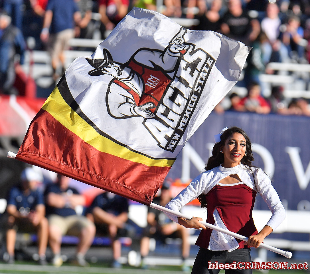 December 29, 2017; Tucson, AZ, USA;  A member of the New Mexico State Aggies marching band's color guard performs before the team's game against the Utah State Aggies during the NOVA Home Loans Arizona Bowl at Arizona Stadium in Tucson, Ariz.  Photo by Sam Wasson/bleedCrimson.net