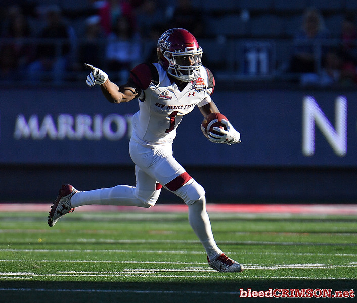December 29, 2017; Tucson, AZ, USA;  New Mexico State Aggies running back Jason Huntley (1) runs for a gain against the Utah State Aggies during the NOVA Home Loans Arizona Bowl at Arizona Stadium in Tucson, Ariz.  Photo by Sam Wasson/bleedCrimson.net
